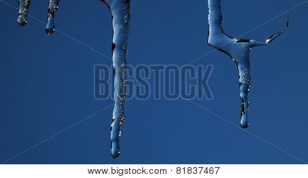 icicles against a  blue winter sky