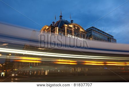 Amsterdam Tram Passing By De Bijenkorf In Dam Square