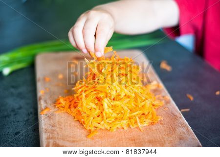 Child Taking Grated Carrots
