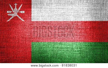 Oman flag on burlap fabric