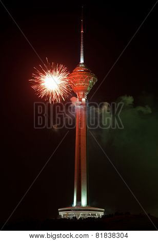 Milad Tower Illuminated With Red Firework Against Black Sky