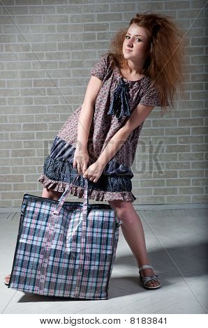 Tired Redhaired Woman With Shopping Bag