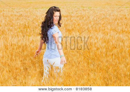 Young Girl On Wheat Field