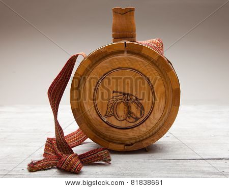 Old Wooden Bottle On Wooden Background