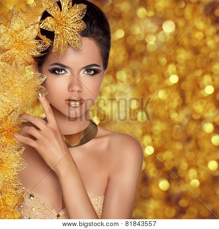 Glamorous Beauty Fashion Girl Portrait. Beautiful Young Woman With Golden Flowers Over Holiday Bokeh