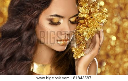 Fashion Beauty Girl Portrait. Eyes Makeup. Golden Jewelry. Attractive Woman Model With Long Brown Ha