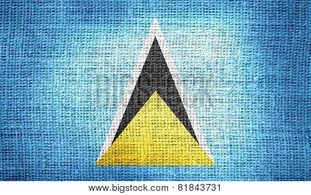 Saint Lucia flag on burlap fabric