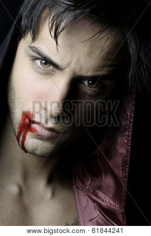 Portrait Of A handsome Vampire With Blood Flowing From The Mouth