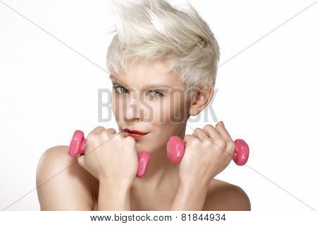 Pretty Young Model Plays With Pink Dumbbells