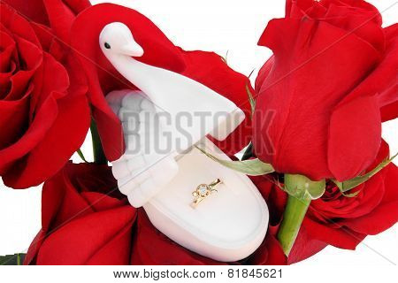 Gold Ring In A Box In The Form Of A Swan On Red Roses