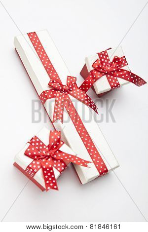The White Boxes With A Red Ribbon And Bow Isolated