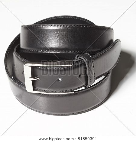 Black belt with a simple buckle on white background