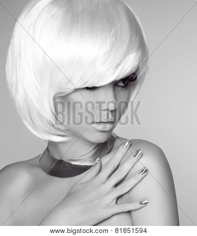 Blond Bob Hairstyle. Beauty Portrait Of Fashionable Girl Model Posing Over Studio Gray Background.