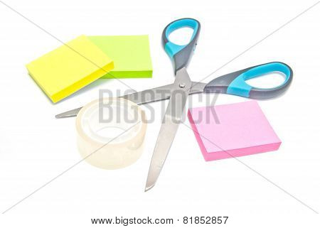 Scotch Tape, Scissors And Sticky Notes On White