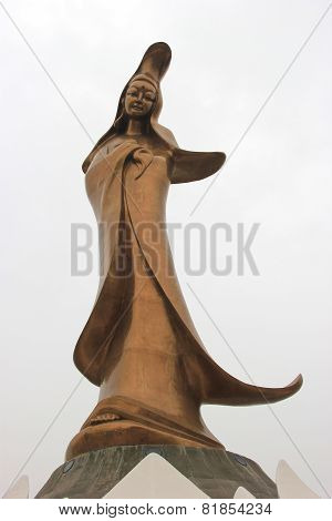 The Bronze Statue Of Goddess Kun Iam, A Buddhist Deity Of Mercy, Situated On A Man-made Island In Ma