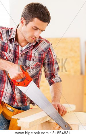 Handyman Using Saw.