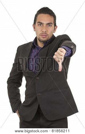 Elegant confident latin man in a suit gesturing defeat holding thumb down