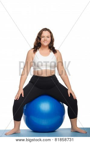 Fat Woman Sitting On Blue Ball Fitness