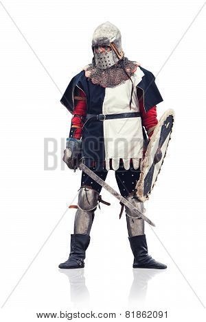 Medieval Knight With The Sword And Shield. Isolated On White.