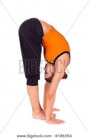 Woman Practicing Standing Forward Bend Yoga Exercise