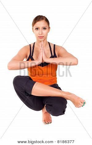 Young Fit Woman Practicing Yoga Exercise