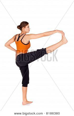 Young Attractive Fit Woman Practicing Yoga