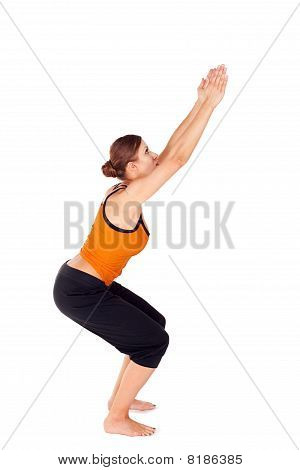 Woman Practicing Yoga Exercise Called Chair Pose
