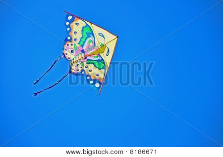 colorful kite soaring in a blue sky