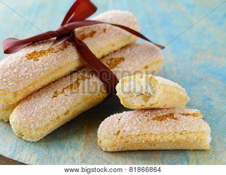 traditional Italian biscuit cookies savoryadi (for tiramisu) on a wooden table