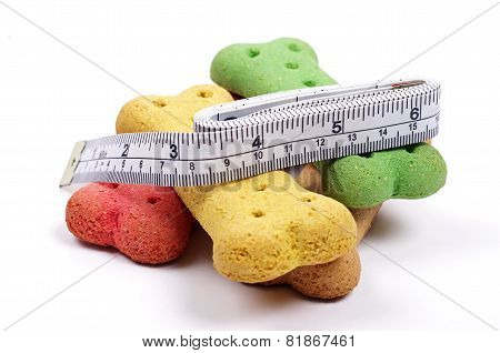 dog treats and measuring tape