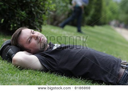 Man Is Lying On Grass