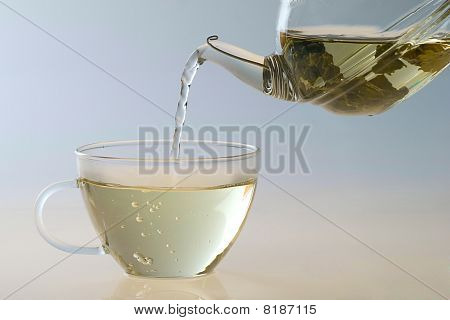 Pouring Tea To A Transparent Teacup