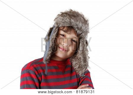 Smiling boy in furry hat