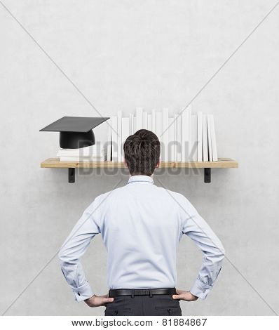 Student Looking On Shelf