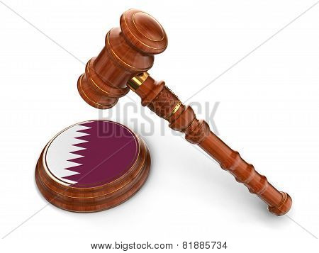 Wooden Mallet and Qatar flag (clipping path included)