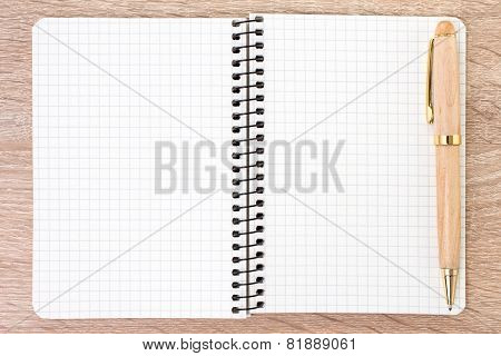 White Open Notebook And Pen