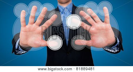 Businessman fingers are touching the space in front of him at visual touch screen - Stock Image