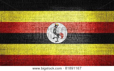 Uganda flag on burlap fabric