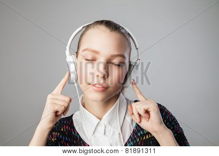 girl in headphones with closed eyes and smile