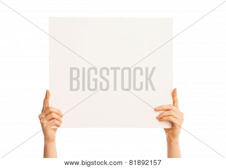 Isolated hands holding a big piece of paper