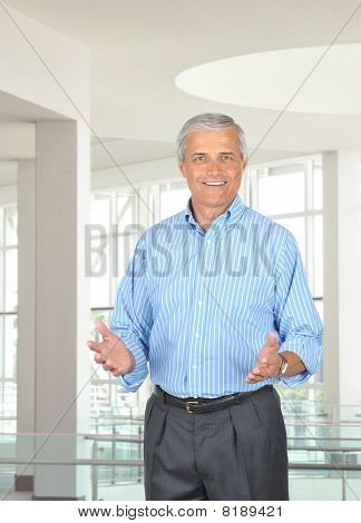 Middle Aged Businessman Both Hands Extendes
