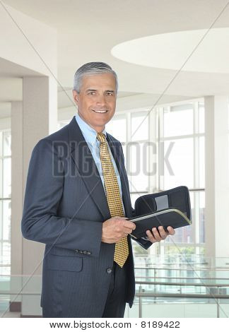 Smiling Businessman With Planner