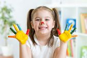 foto of nursery school child  - Cute child little girl with painted hands - JPG