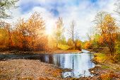 picture of ural mountains  - Mountain stream forest autumn landscape at sunset - JPG