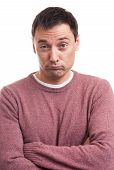 stock photo of sarcastic  - Skeptical man looking at camera isolated on white - JPG