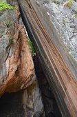 stock photo of kan  - Smooth steep cleft on the Phing Kan Island - JPG