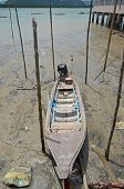 pic of gypsy  - Wooden boat at low tide in the floating village of sea gypsies in the Andaman Sea - JPG