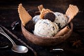 pic of ijs  - Ice cream with cookies and cone in wooden bowlselective focus