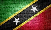 stock photo of civil war flags  - Grunge of Saint Kitts and Nevis flag on burlap fabric - JPG