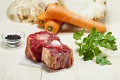 stock photo of oxen  - raw ox tail with ingredients on wood - JPG